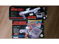 Super Nintendo boxed with scope and 9 games