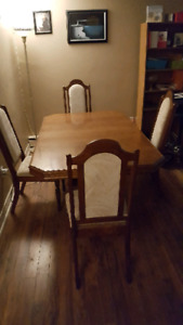Oak dining table with matching chairs and leaf