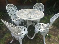 Victorian style garden table and four chairs