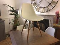 4x Replica Eames white plastic and wood chairs