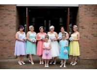 Never worn 5 pastel knee length bridesmaid dresses. Would suit other formal occassions