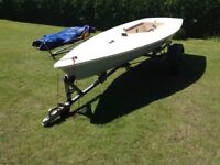 Mk 1 Laser sailing dinghy c/w road trailer & launching trolley. All ready for the water.