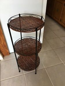 Wicker stand. Great for bathroom or kitchen