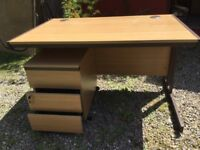 Pine laminate finish desk with useful 3 drawer unit on casters.