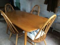 1970s VINTAGE ERCOL BLONDE PLANK TABLE AND FOUR CHAIRS