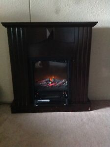 Electric heater/fake fireplace - Used $100