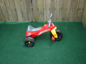 Red tricycle for kids