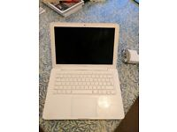 """Macbook A1342 White 13"""" Laptop, some small cracks and scuffs but works perfectly"""