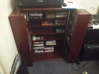 160 CDs with some DVDs and Blue ray in dark wood cabinet.