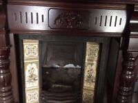 Immaculate period cast iron fireplace with tile inlay and mahogany surround inc grate
