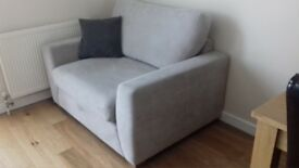 Silver snuggle chair and matching storage footstool