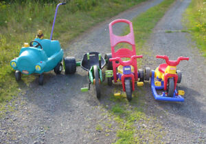 high end kids tricycles and a padel power tracter/cars/bicycles
