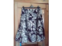 Ladies black, grey, silver and gold skirt
