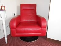 Red leather swivel chair with chrome base.
