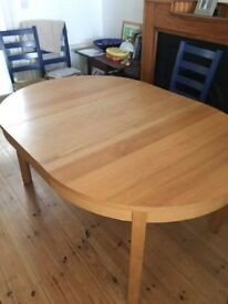 Ikea dining table, hardly used extends to over 5 foot.