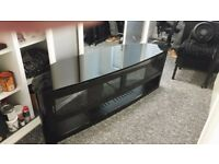 Tv console. Black glass topped, glass doored console 65inch. Comparments for accessories.