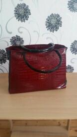 Red and black leather hand bag