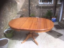 Pine Table . Good solid and adjustable . Can be dismantled for transportation .