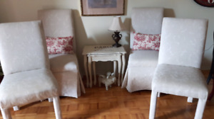 Four parson dining chairs head of the table chairs are skirted