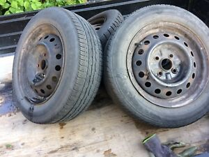 4 summer tires with rims 175/65/14.  Toyota echo 2004