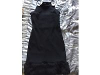 Black bodycon dress with fur lining at bottom - size 10