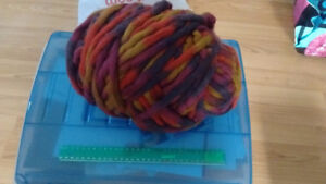 Large roll of extra thick yarn, plus other leftover rolls