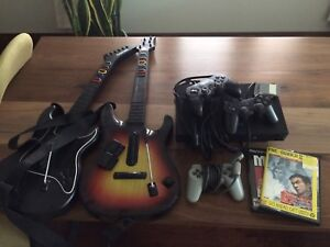 PS2 console with guitars and games