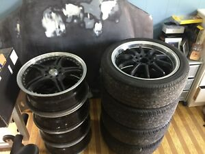 "Two sets of 17"" 4x100/4x114.4 rims"