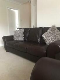 leather sofas and poufe