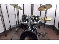 Retired drum teacher has a Yamaha Stage Custom 'Fusion' drum kit in Black for sale.