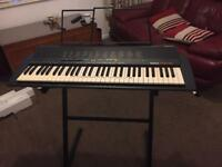 Yamaha PSR18 with original box, music stand, instruction book and stand