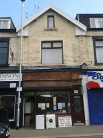 shop and 2 bedroom flat all in 1 busy main Rd location nr town