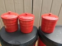 Set of red canisters