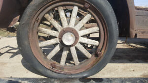 Four 12 spoke wooden wheels for 1928 chev