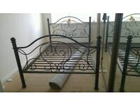 Metal double bed frame with mattress