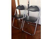 2 BRAND NEW padded folding chairs - black