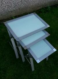 Nest of glass and chrome tables. FREE