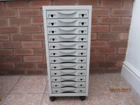Filing cabinet 12 drawer excellent condition.
