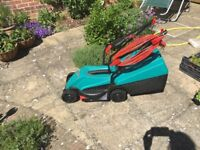 Electric rotary lawn mower for sale.