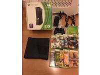 Xbox 360 slim , boxed with 10 games - £69