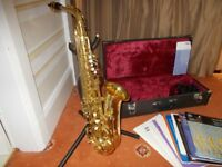 YAMAHA YAS-25 Alto Saxophone complete with leather case, stand, strap and 12 music books.