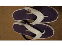 Woman 7.5 flip flops shoes.