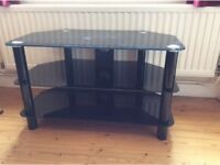 Black TV stand. Three tier TV stand. 80 (w) x 45 (l) x 48 (h) cm. Good condition.