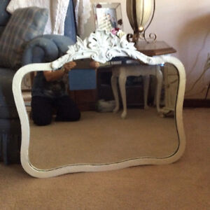 Hand carved wooden antique mirror done in Annie Sloan old white.