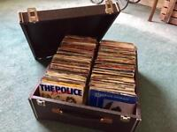 "Over 300 mixed 7"" singles in carrying case"