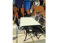 large garden table and 4 chairs