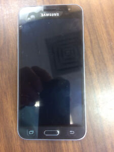 Samsung Galaxy J3 cell phone with accessories