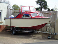 16 foot boat compleatley refurbished, brand new trailer, and Suzuki DT 25hp outboad.d