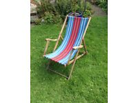 Vintage deck chair with arms