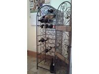 Ornate metal wine rack